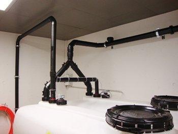 BioTrans rørsystem fra affaldskværn til lagring i en biotank